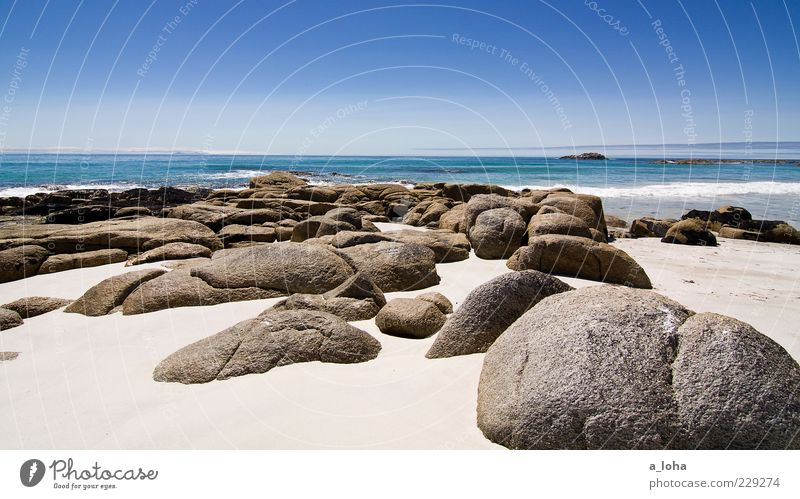 Sky Nature Water Ocean Summer Beach Far-off places Landscape Warmth Sand Coast Stone Waves Horizon Earth Rock