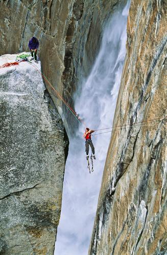 Rock climbing team reaching the summit. Adventure Mountain Sports Climbing Mountaineering Rope Friendship 2 Human being Peak Waterfall Athletic Tall Power