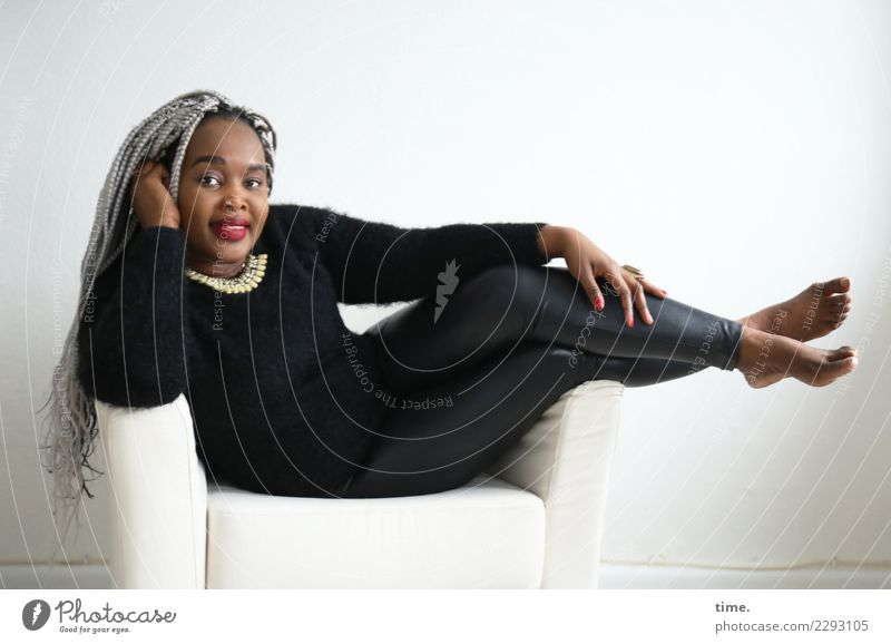 gené Armchair Room Feminine Woman Adults 1 Human being Pants Sweater Jewellery Barefoot Hair and hairstyles Black-haired Gray-haired Long-haired Braids Afro