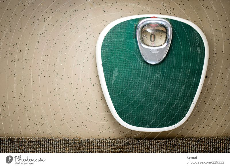 The zero is Overweight Scale Carpet Edge Floor covering Old Green Weigh bathroom scales Seventies Retro Weight problems Colour photo Interior shot Day Light