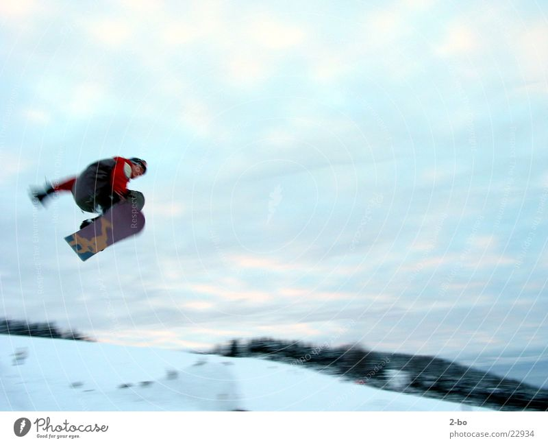 flying high Snowboard Jump Extreme sports Harz Motion blur Tall Brave Posture Snowboarder Snowboarding Flying Clouds in the sky 1 Exterior shot Colour photo