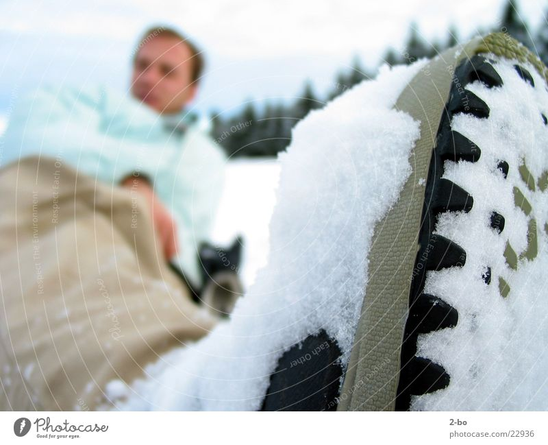 A day in the snow Snow Jonny Shallow depth of field Winter sportswear Winter clothing Anonymous Lie Exterior shot Colour photo Snowboarder Shoe sole Rough Burl
