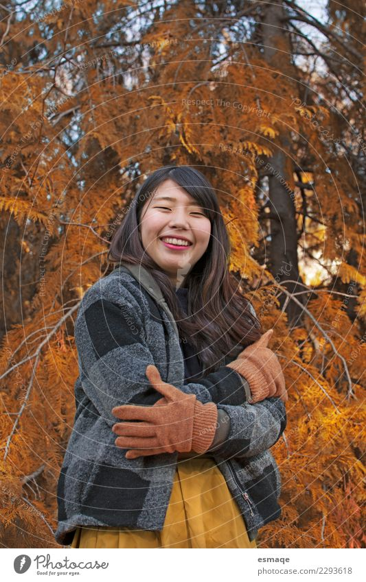 Asian girl smiling in nature Lifestyle Exotic Joy Beautiful Healthy Vacation & Travel Feminine Young woman Youth (Young adults) Nature Tree Clothing Gloves