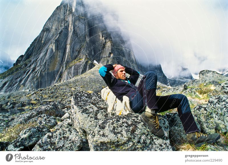Backpacker resting. Human being Loneliness Adults Sports Mountain Sit Hiking Adventure Climbing Peak Discover Athletic Top Vertical Willpower Mountaineering