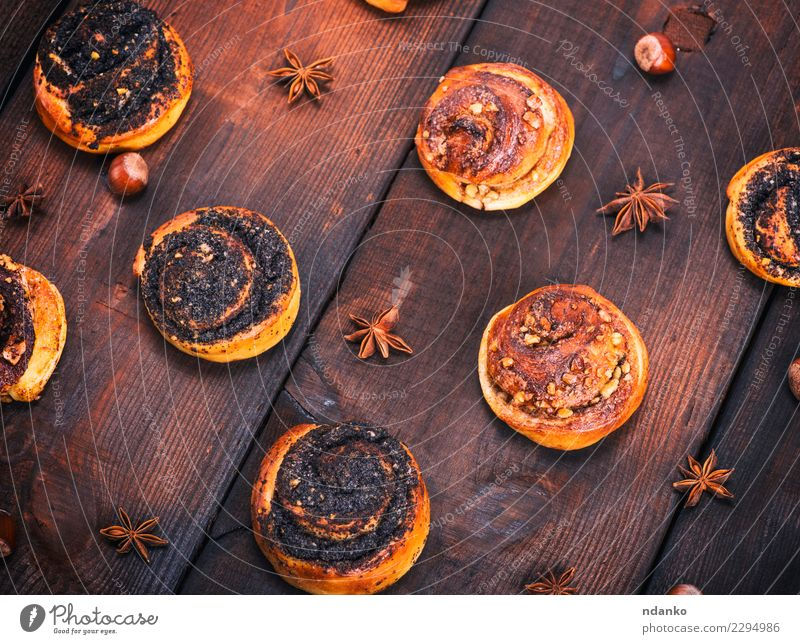 round yeast buns with poppy seeds Bread Roll Dessert Breakfast Table Kitchen Wood Eating Fresh Delicious Natural Above Brown Tradition Swirl background Baking
