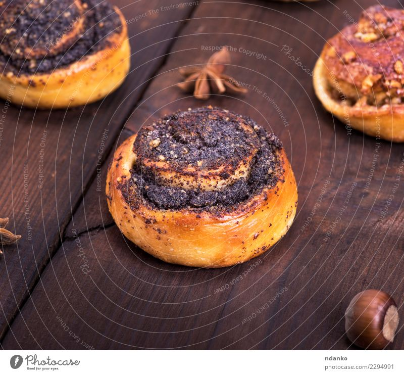 round poppy and nut buns Eating Natural Wood Brown Above Fresh Table Kitchen Delicious Breakfast Tradition Poppy Dessert Baked goods Roll Rustic