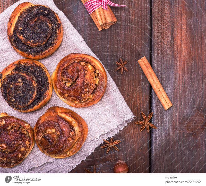 round poppy and nut buns Roll Dessert Candy Breakfast Table Wood Eating Fresh Delicious Above Brown Tradition food Poppy Rustic Bakery background sweet Cinnamon