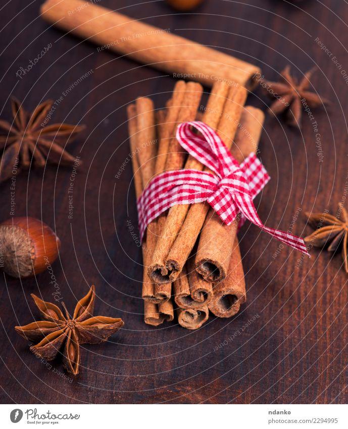 brown cinnamon sticks Dark - a Royalty Free Stock Photo from Photocase