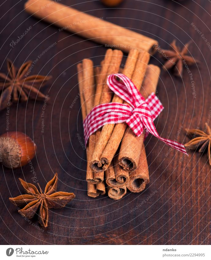 brown cinnamon sticks Food Herbs and spices Decoration Table Wood Dark Natural Brown Cinnamon background Rustic Ingredients star Aromatic anise Consistency