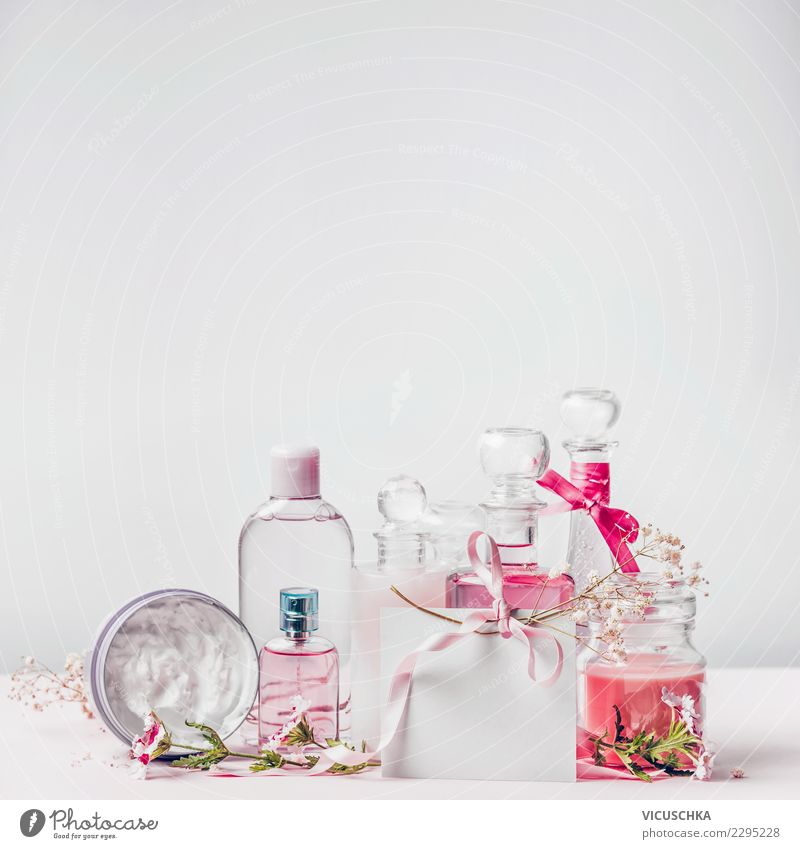 Cosmetic bottles with greeting card Shopping Style Design Beautiful Cosmetics Perfume Cream Healthy Spa Decoration Hip & trendy Pink Background picture Bottle