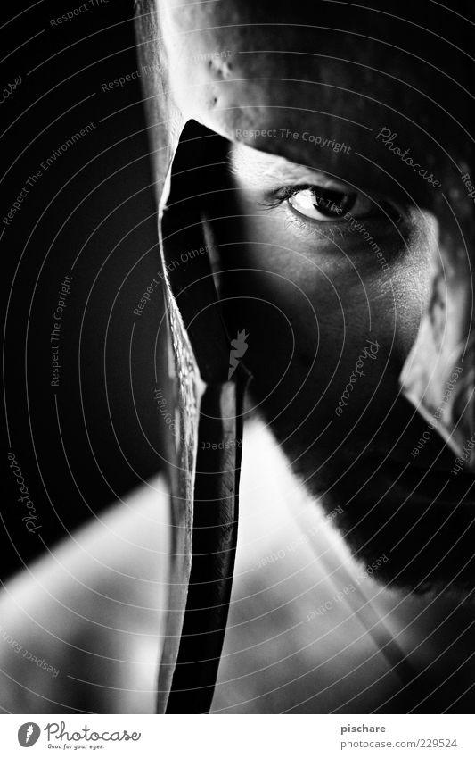 Man Adults Eyes Dark Power Wait Masculine Threat Symbols and metaphors Anger Historic Facial hair Aggression Helmet Sharp-edged Rebellious