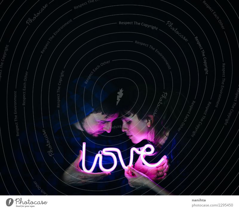 Young couple holding a neon light with love Human being Youth (Young adults) Young woman Young man Dark 18 - 30 years Black Face Adults Life Love Feminine Style