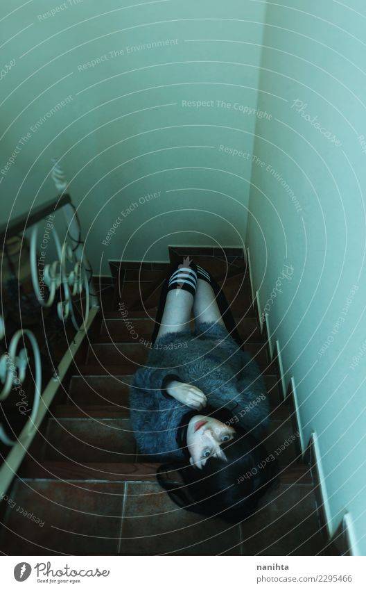 Young creepy woman lying down over a stairs Woman Human being Youth (Young adults) Young woman House (Residential Structure) Loneliness Dark 18 - 30 years