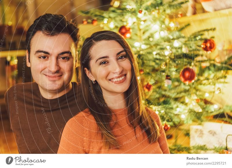 Happy Couple Portrait And Christmas Tree Woman Human being Youth (Young adults) Man Christmas & Advent Young woman Colour Beautiful Green Young man Red