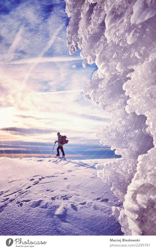 Ice formations with cross-country skier silhouette Vacation & Travel Tourism Adventure Expedition Winter Snow Mountain Skis Nature Landscape Sky Climate Effort
