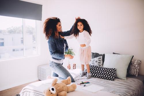 Young mom playing with little daughter Joy Happy Beautiful Playing House (Residential Structure) Bedroom Parenting Child Parents Adults Mother