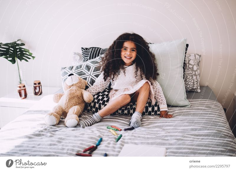 Little african girl sitting on bed with teddy bear smiling Joy Happy Beautiful Playing Child Human being Infancy Teddy bear Laughter Sit Jump Happiness Small