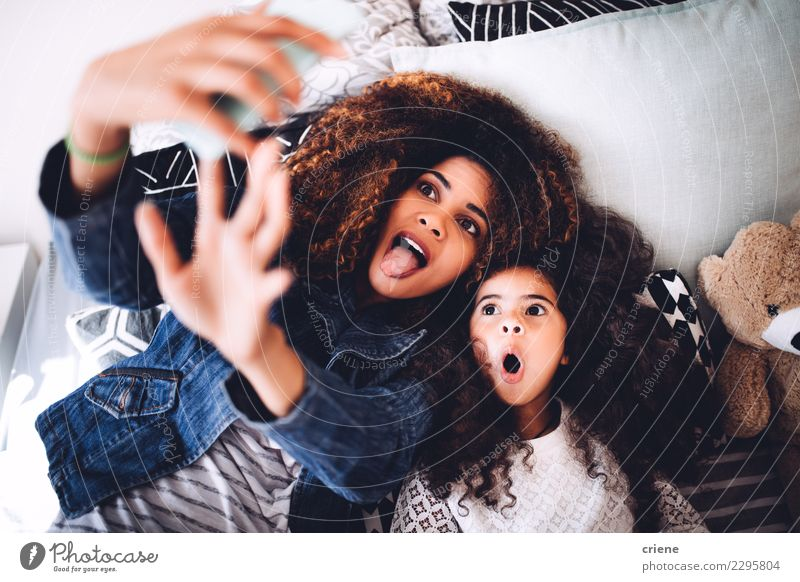 Young mom and daughter taking funny selfie with tablet Child Woman Beautiful Joy Black Adults Lifestyle Family & Relations Happy Together Smiling Photography