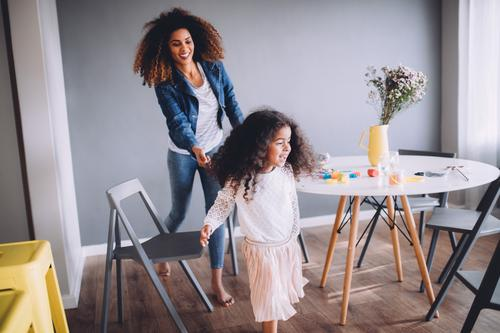 Mother and Daughter having fun at home. Joy Happy Playing Table Kindergarten Child School Woman Adults Parents Family & Relations Infancy Paper Pen Together