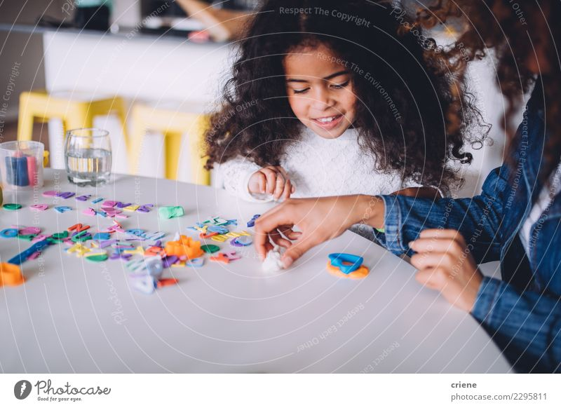Little african girl playing with clay at home Child Woman Joy Adults Family & Relations Happy Playing School Together Infancy Table Cute Paper Mother Parents