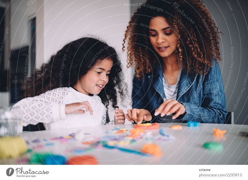 African Mother and daughter playing with toys together Child Woman Joy Adults Family & Relations Happy Playing School Together Infancy Table Cute Paper Parents