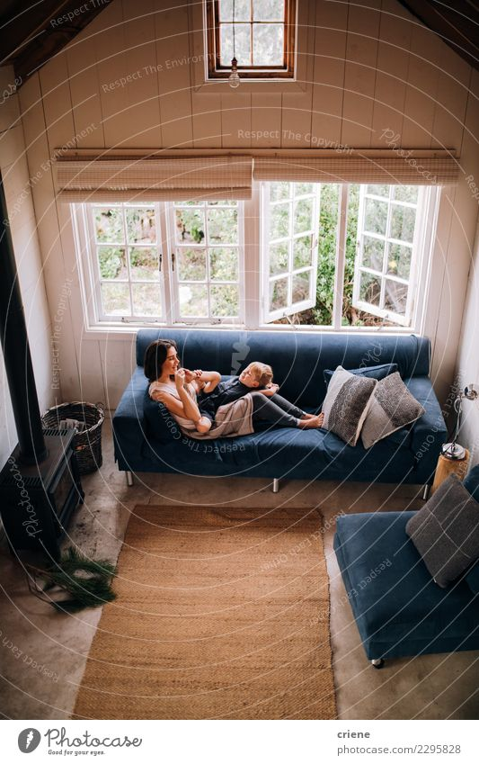 Caucasian mother and toddler boy cuddle together on couch Child Woman House (Residential Structure) Joy Adults Lifestyle Love Family & Relations Boy (child)