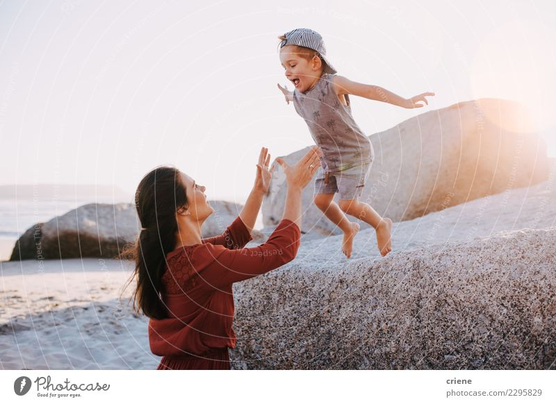 Happy mother and son having fun on beach on vacation Child Woman Nature Vacation & Travel Summer Beautiful White Sun Ocean Joy Beach Adults Lifestyle Love