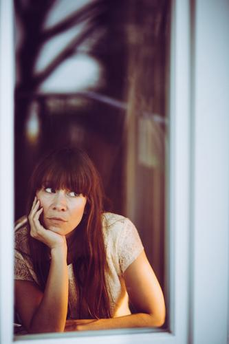 The window gazer Feminine Woman Adults 1 Human being 30 - 45 years Observe Touch Think Looking Dream Sadness Wait Curiosity Boredom Concern Lovesickness Longing
