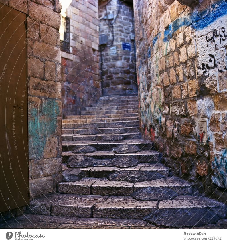 there it is written Old town Deserted Architecture Wall (barrier) Wall (building) Stairs Facade Exceptional Authentic Sharp-edged Simple Large Beautiful Gloomy
