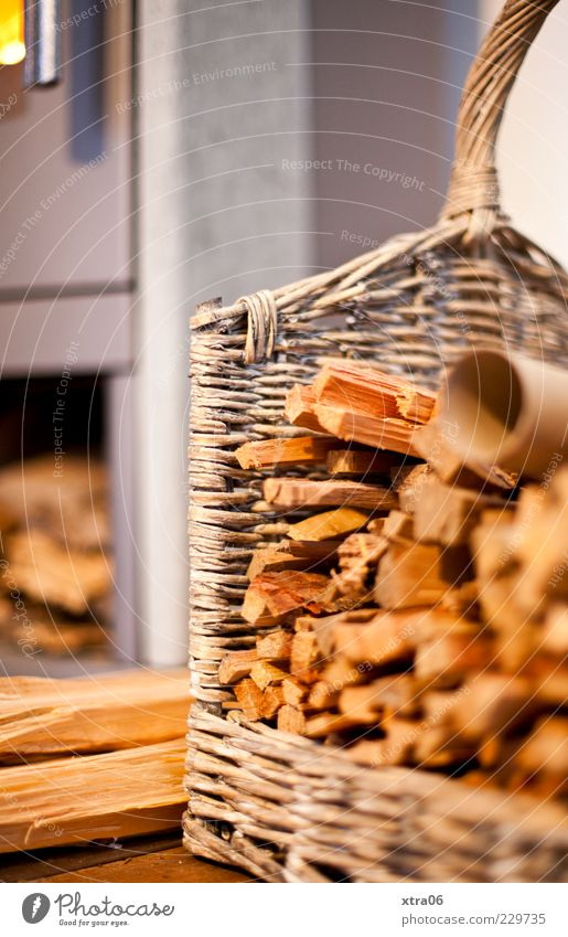 warmth Wood Brown Basket Firewood Fireside Colour photo Interior shot Deserted Copy Space left Copy Space top Blur Detail Stack of wood
