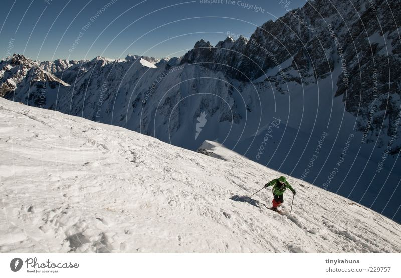 Human being Nature Blue White Vacation & Travel Winter Cold Snow Sports Landscape Freedom Mountain Above Gray Movement Trip