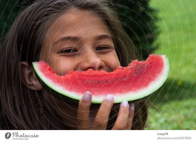 Smiling girl with a bitten melon in front of her mouth Joy Summer Garden Child Girl Infancy 1 Human being 8 - 13 years Brunette Eating Laughter Happiness Happy