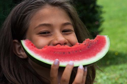 That's mine. Joy Summer Garden Child Girl Infancy 1 Human being 8 - 13 years Brunette Eating Smiling Laughter Happiness Happy Joie de vivre (Vitality) Fruit