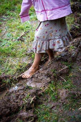 childhood Playing Parenting Child Feminine Girl Body 1 Human being 3 - 8 years Infancy Summer Autumn Meadow Muddy Skirt Going Poverty Authentic Wet Natural