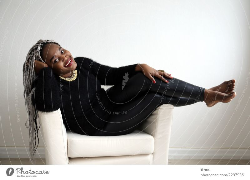 gené Armchair Room Feminine Woman Adults 1 Human being Pants Sweater Barefoot Hair and hairstyles Black-haired Gray-haired Long-haired Afro Plaited Relaxation