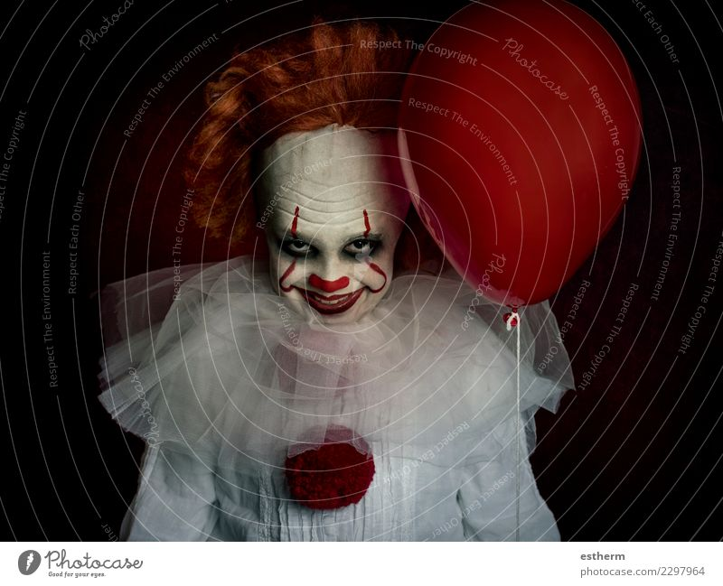 boy dressed as a clown on black background Lifestyle Entertainment Party Event Feasts & Celebrations Carnival Hallowe'en Fairs & Carnivals Human being Masculine