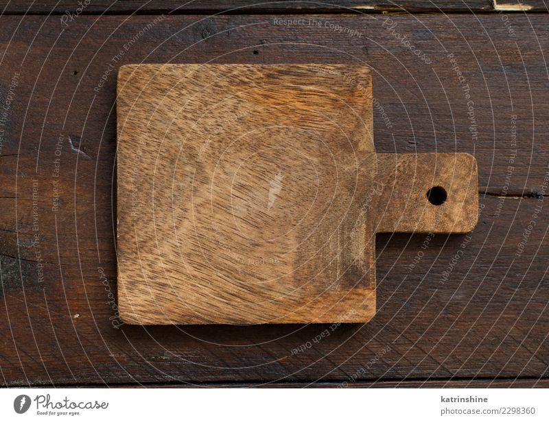 Wooden table and old cutting board, top view, copy space - a