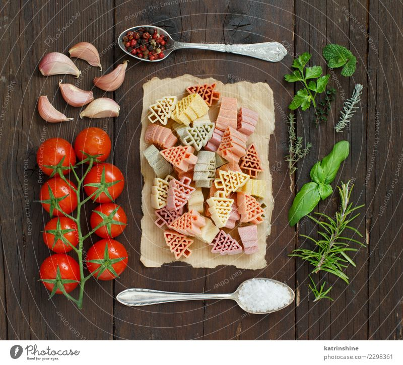 Tricolor pasta, vegetables and herbs on a wooden background Vegetable Vegetarian diet Diet Spoon Table Tree Dark Fresh Brown Green Red Tradition cooking food
