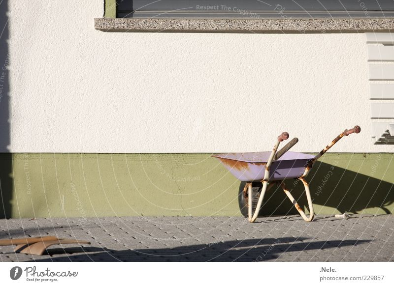 Child labor. Playing Wheelbarrow Wall (building) Stone Old Natural Brown Green Violet White Emotions Orderliness Boredom Comfortable Nostalgia Past