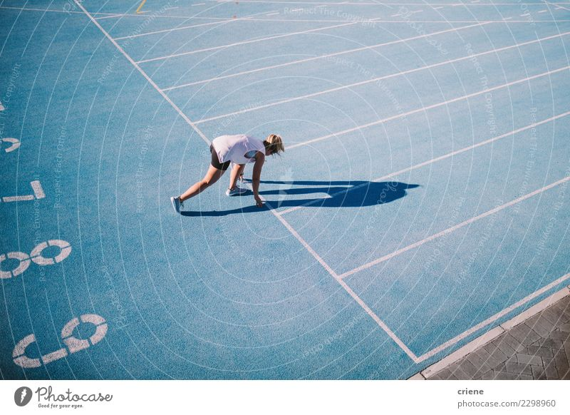Caucasian female athlete running on blue running track Woman Human being Blue Adults Lifestyle Sports Footwear Action Success Beginning Fitness Competition