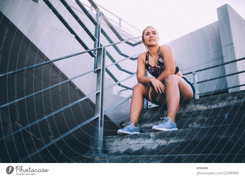 Female athlete having a break from working out Lifestyle Sports Woman Adults Fitness Bright Modern Determination Fatigue Resting running after Practice stairs