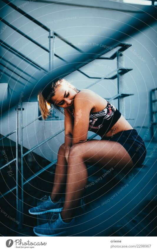 Caucasian fit woman sitting on stairs in sportswear Lifestyle Sports Woman Adults Fitness Bright Modern Determination Fatigue Resting running after Practice