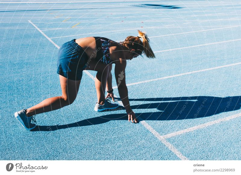 Fit woman practicing for marathon on blue running track Woman Human being Blue Adults Lifestyle Sports Footwear Action Success Beginning Fitness Competition
