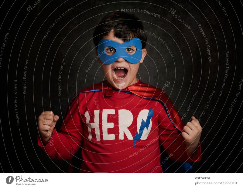 Happy little child playing superhero Child Human being Joy Lifestyle Emotions Movement Playing Feasts & Celebrations Party Masculine Infancy Power Happiness