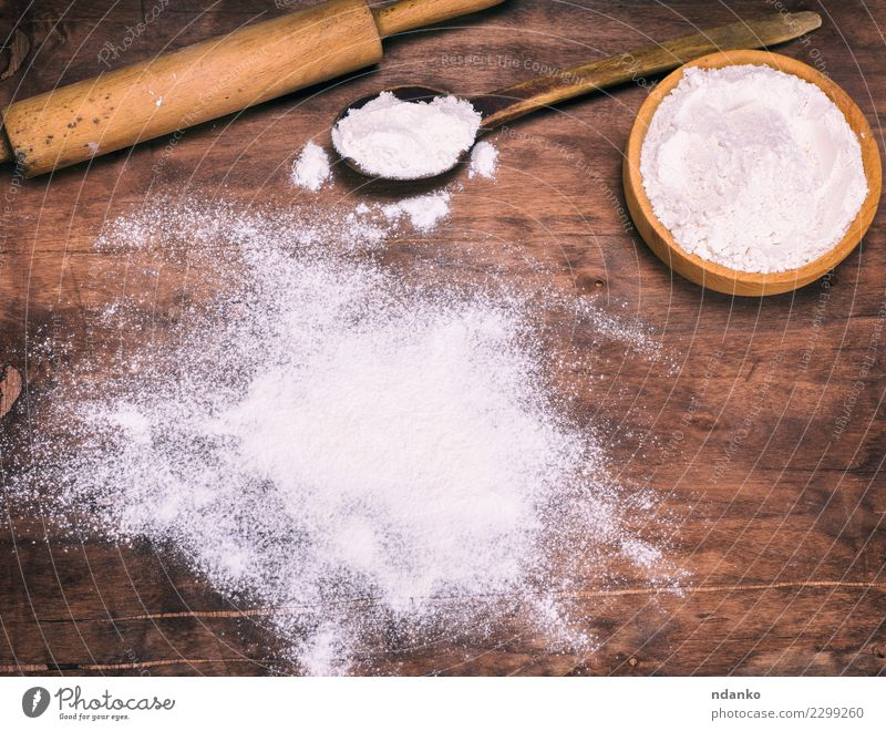 scattered white wheat flour Food Dough Baked goods Bread Bowl Spoon Table Kitchen Wood Retro Brown White Cooking Culinary Baking space board Consistency recipe