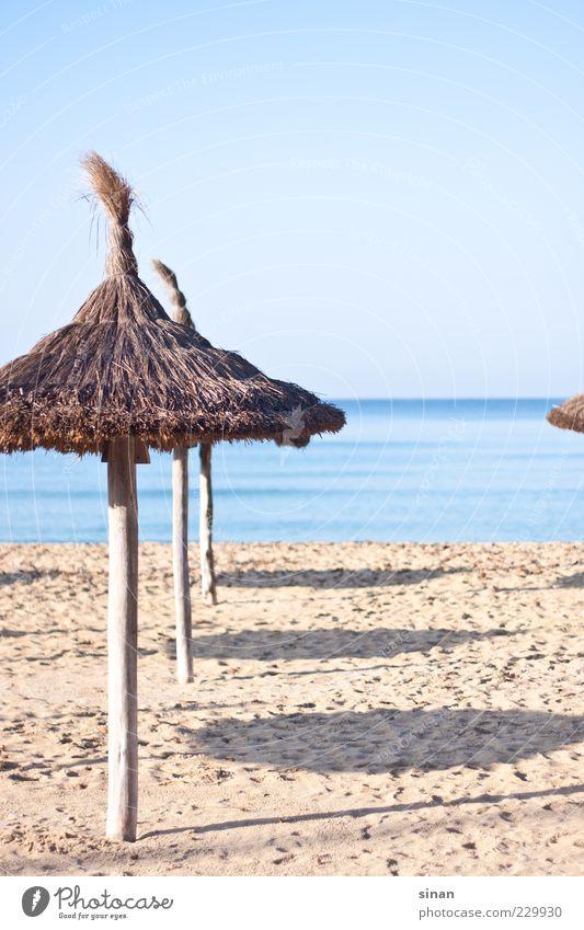 Sunshades on the beach Lifestyle Calm Environment Landscape Sand Water Sky Horizon Summer Beautiful weather Coast Beach Ocean Mediterranean sea Island Majorca