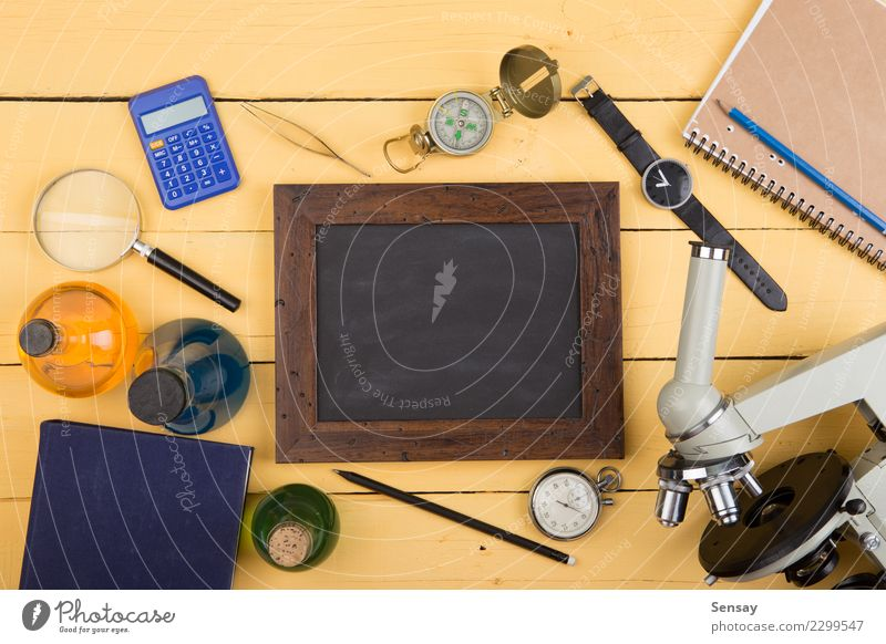 Education concept - microscope on the wooden desk Desk Table Science & Research School Study Classroom Blackboard Academic studies Laboratory Book Library