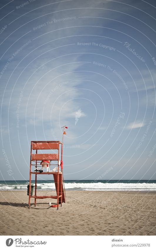 to the beautiful view Beach Ocean Waves Sky Clouds Sit Wait Lifeguard Colour photo Exterior shot Guard Watchfulness Copy Space top Copy Space middle Sandy beach