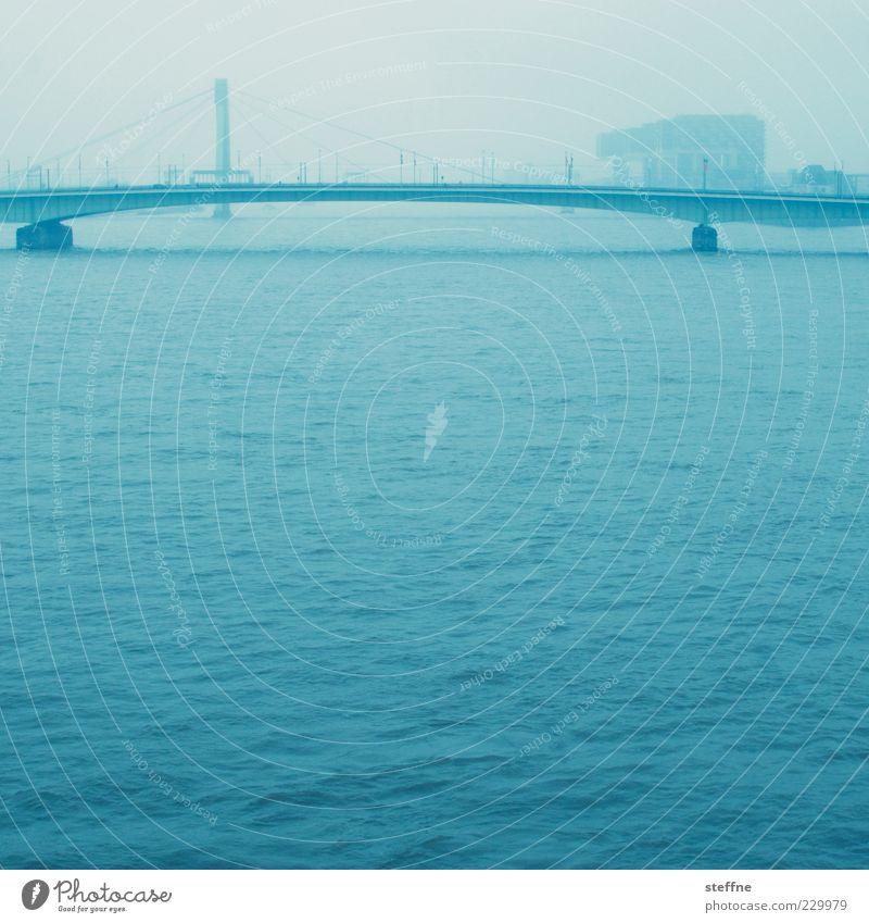 Water Blue City Far-off places Waves Fog Bridge River Traffic infrastructure Cologne Haze Surface of water Rhine Cologne-Deutz Deutzer Bridge