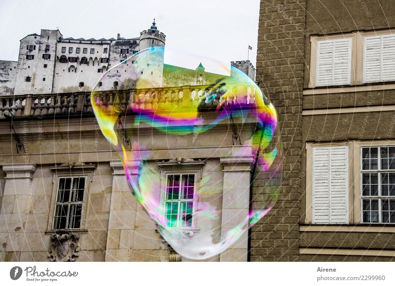 the dream of the castle Playing City trip Salzburg Town Downtown Old town Palace Castle Renaissance Fortress Facade Soap bubble Bubble Sphere Flying Tall Round
